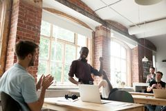 African american team leader performing victory dance in co-work royalty free stock photo
