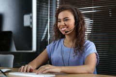 Free African-American Technical Support Operator With Headset Stock Photo - 136921750