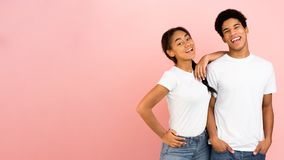 Free African-american Teen Couple Posing On Pink Background Royalty Free Stock Photography - 161196687