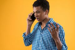 African American teen speaks by cell phone. stock image