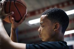 Free African American Teenage Boy Concentrated On Playing Basketball Stock Photo - 113342160