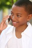 African American Teenager Boy on Cell Phone. Smiling African American Teenager Boy talking on Cell Phone Royalty Free Stock Photo