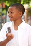 African American Teenager Boy on Cell Phone Royalty Free Stock Photos
