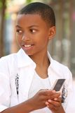 African American Teenager on Cell Phone. Smiling African American Teenager Boy talking on Cell Phone Royalty Free Stock Photography
