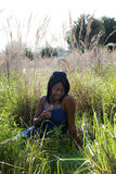 African American teenager in field Stock Photos