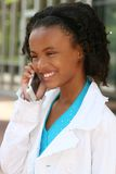 African American Teenager Girl on Cell Phone Stock Images