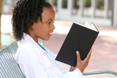 African American Teenager Girl Reading a Book Royalty Free Stock Image