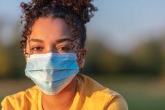 Free African American Teenager Girl Woman Wearing Coronavirus COVID-19 Face Mask Royalty Free Stock Image - 182634116
