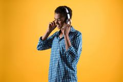 African American teenager in headphones listens to music. royalty free stock photo