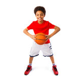 African american teenager playing basketball Stock Photo