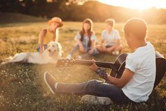 African american teenager playing guitar Stock Photo