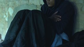 African-american teenager spending nights in cold underground passage, poverty
