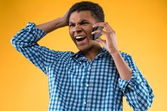 African American teenager yelling in cell phone. stock image