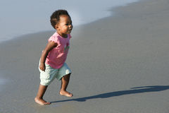 African American toddler running on the beach royalty free stock photography