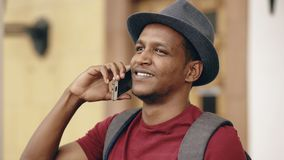 African american tourist man chatting with smartphone while travelling in Europe. An country Royalty Free Stock Photos