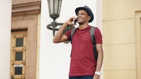 African american tourist man chatting with smartphone while travelling in Europe. An country Stock Image
