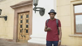 African american tourist man using smartphone online map to find right directions standing at street stock video