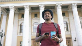 African american tourist man using smartphone online map to find right directions standing at street stock video footage