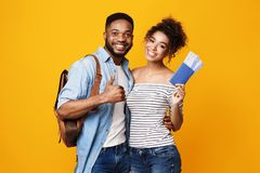 African-American Tourists Showing Thumbs Up, Orange Background stock photography