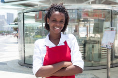 African american waitress in front of the restaurant Stock Images
