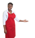 African american waitress inviting guests. On an isolated white background for cut out Stock Image