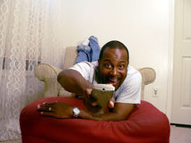 African american watching tv 3 Stock Image