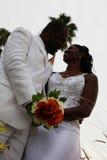 African american wedding couple. Half body portrait of an african american couple holding bouquet of flowers stock photo