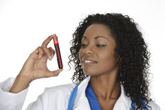 African American woman laboratory technician examining a tube of blood Stock Images