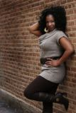 African American Woman. A sexy woman poses against a wall Royalty Free Stock Photo