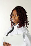 African American woman. A studio portrait of an African American woman wearing a white business shirt and tie, and carrying a white binder Stock Photo