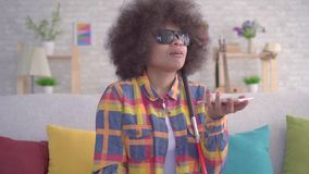 African american woman with an afro hairstyle visually impaired uses voice assistant on your smartphone close up stock video footage