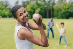 African american woman with baseball ball Stock Images