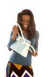 African American woman blue top look in purse Stock Photography