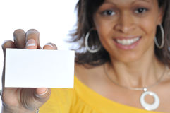 African-american woman with businesscard. African-american woman holding a blank businesscard on a white background Stock Images