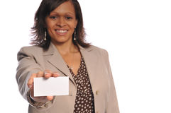 African-american woman with businesscard. African-american woman holding a blank businesscard on a white background Stock Photo