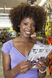 African American woman buying tool at hardware store Stock Photo