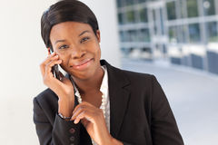African-American Woman on cell phone Stock Images
