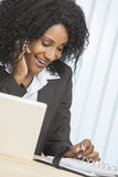 African American Woman Cell Phone & Laptop Office royalty free stock photography