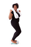 African American woman cheering on scale  - African people Royalty Free Stock Images