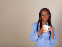 African American Woman with a Coffee Cup Royalty Free Stock Photos