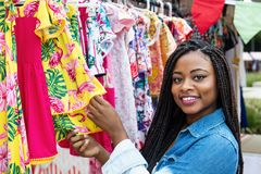 African american woman with colorful clothes at market. African american woman with colorful clothes outdoors at typical traditional market Stock Image