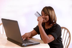 African-American woman on the computer. African-American woman online shopping on the computer stock photography