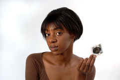 African American woman with condom Royalty Free Stock Photography