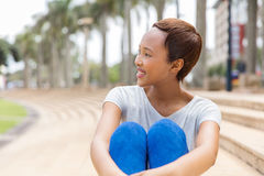 African american woman daydreaming stock photo
