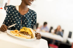 African american woman in diner. Young african american woman eating in the diner Stock Photo