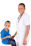 African american woman doctor with child Royalty Free Stock Photo