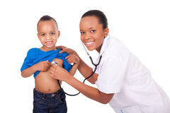 African american woman doctor with child Stock Photos