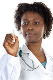 African american woman doctor writing Stock Image