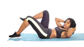 African American woman doing exercises. royalty free stock images