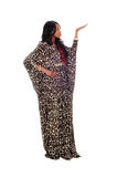 African American woman in dress pointing up. Royalty Free Stock Image